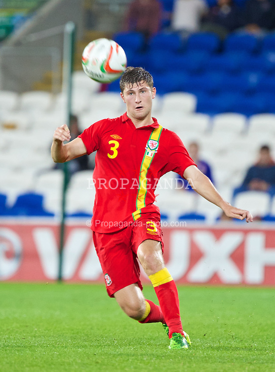 CARDIFF, WALES - Wednesday, August 14, 2013: Wales' Ben Davies in action against Republic of Ireland during an International Friendly at the Cardiff City Stadium. (Pic by David Rawcliffe/Propaganda)