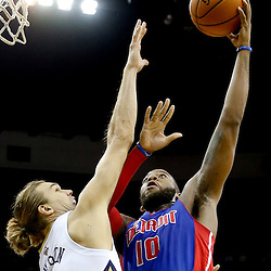 Dec 11, 2013; New Orleans, LA, USA; Detroit Pistons power forward Greg Monroe (10) shoots over New Orleans Pelicans power forward Lou Amundson (17) during the second half at New Orleans Arena. The Pelicans defeated the Pistons 11-106 in overtime. Mandatory Credit: Derick E. Hingle-USA TODAY Sports