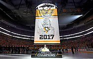 PITTSBURGH, PA - OCTOBER 4:  The Pittsburgh Penguins watch the 2017 Stanley Cup banner raised to the rafters before the game against the St. Louis Blues at PPG Paints Arena on October 4, 2017 in Pittsburgh, Pennsylvania.  (Photo by Joe Sargent/NHLI via Getty Images) *** Local Caption ***