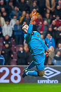 Liam Kelly (#1) of Livingstone FC makes a save during the Ladbrokes Scottish Premiership match between Heart of Midlothian and Livingston at Tynecastle Stadium, Edinburgh, Scotland on 6 February 2019.