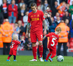 LIVERPOOL, ENGLAND - Sunday, May 11, 2014: Liverpool's Daniel Agger with his children after the Premiership match against Newcastle United at Anfield. (Pic by David Rawcliffe/Propaganda)