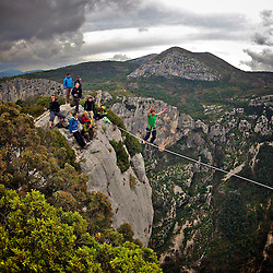 "Nadeem AL-Kafaji onsighting an highline in Gorges du Verdon's sector of  Dalles Grises, France, while Julien Millot, from feature documentary ""Flight of the frenchies""  throws himself into a 300m cliff BASE jump...© 2012 Pedro Pimentel"