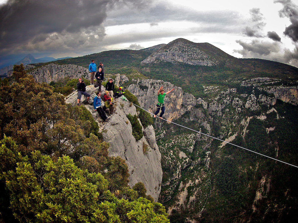 """Nadeem AL-Kafaji onsighting an highline in Gorges du Verdon's sector of  Dalles Grises, France, while Julien Millot, from feature documentary """"Flight of the frenchies""""  throws himself into a 300m cliff BASE jump...© 2012 Pedro Pimentel"""