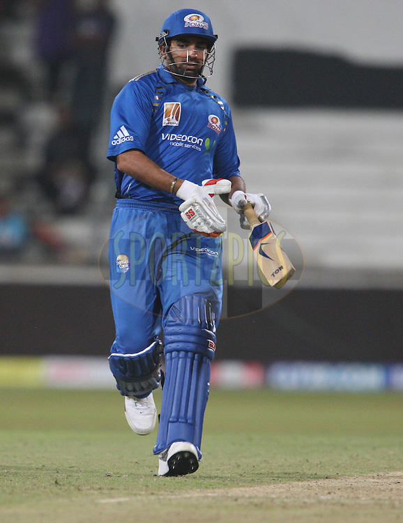 Zaheer Khan makes a run down the wicket during match 15 of the Airtel CLT20 between The Mumbai Indians and the Royal Challengers Bangalore held at Kingsmead Stadium in Durban on the 19 September 2010..Photo by: Steve Haag/SPORTZPICS/CLT20.
