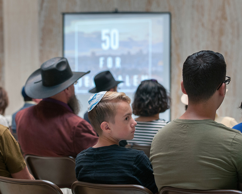em060717g/a/Ari Rosenmader, 13, attends a ceremony to watch a live stream of ceremonies commemorating the 50th anniversary of the reunification of Jerusalem. This ceremony was held in the Rotunda of the State Capitol in Santa Fe Wednesday June 7, 2017. The events they were streaming were from Jerusalem and Washington D.C. Around 40 people including some state legislators attended the event that was organized by the Santa Fe Jewish Center and the Jewish Federation. (Eddie Moore/Albuquerque Journal)