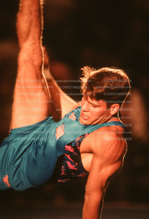 SAN JOSE - JULY 18:  Chris Waller of the United States competes in the floor exercise during the San Jose Gymnastics Spectacular held on July 18, 1993 in the Event Center at San Jose State University in San Jose, California.  (Photo by David Madison/Getty Images)