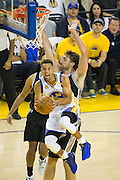 Golden State Warriors guard Stephen Curry (30) takes the ball to the basket against the San Antonio Spurs at Oracle Arena in Oakland, Calif., on October 25, 2016. (Stan Olszewski/Special to S.F. Examiner)