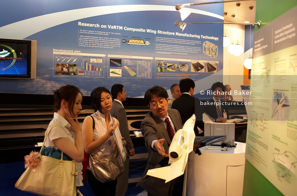 Delegates are shown wing composite technology by man from Japan Aerospace Exploration Agency at the Paris Air Show exhibition