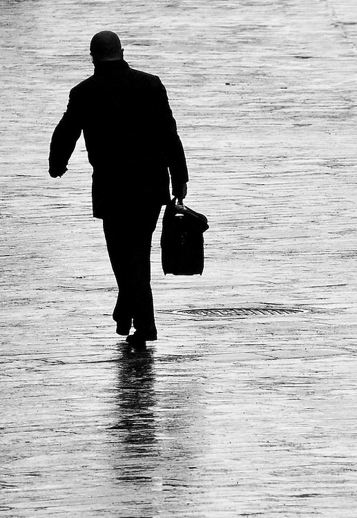 """Black and white photography. A silhouette man walking in Bologna Italy by Karl R Lilliendahl photographer.This photo is available as open edition and limited edition giclee print in four sizes. Click on """"Get Print"""" to see more details."""