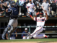 CHICAGO - APRIL 23:  Jose Abreu #79 of the Chicago White Sox slides safely into home against the Cleveland Indians on April 23, 2017 at Guaranteed Rate Field in Chicago, Illinois.  The White Sox defeated the Indians 6-2.  (Photo by Ron Vesely)   Subject:  Jose Abreu