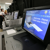 """Forrest Phillips of hattiesburg continues to run """"acceptance tests"""" for the 45 new voting machines at the Lee County Circuit Clerk's Office Wednesday."""