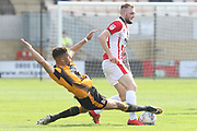 Jake Carroll tackles Carl Winchester during the EFL Sky Bet League 2 match between Cambridge United and Cheltenham Town at the Cambs Glass Stadium, Cambridge, England on 21 April 2018. Picture by Antony Thompson.