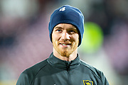 Alan Lithgow (#4) of Livingston FC warms up before the Ladbrokes Scottish Premiership match between Heart of Midlothian FC and Livingston FC at Tynecastle Park, Edinburgh, Scotland on 4 December 2019.