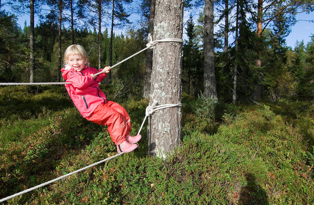 Girl in a Norwegian naturbarnehage (nature nursery) rope walking