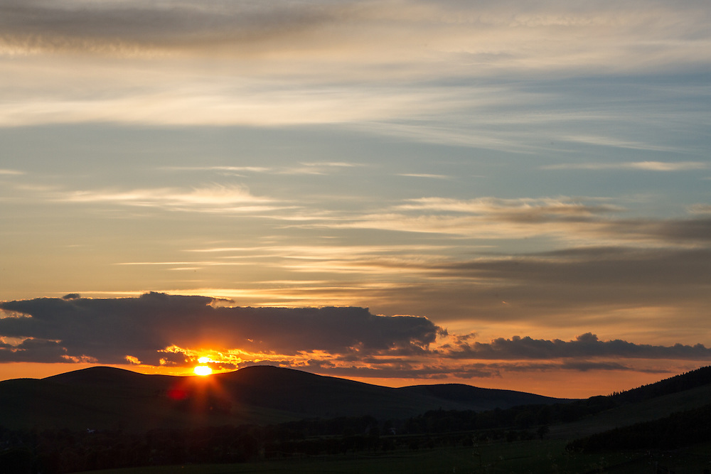 Dramatic summer sunset skies over Upper Tweeddale in the Scottish Borders