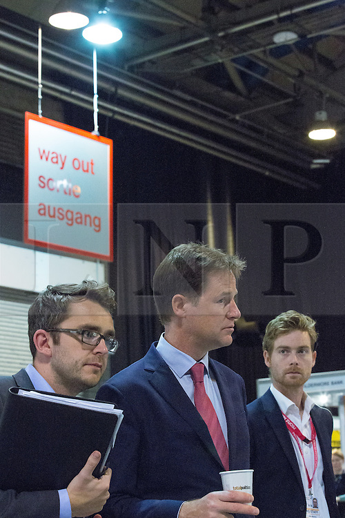© Licensed to London News Pictures . 06/10/2014 . Glasgow , UK . Deputy Prime Minister and Liberal Democrat Party Leader NICK CLEGG with advisers . The Liberal Democrat Party Conference 2014 at the Scottish Exhibition and Conference Centre in Glasgow . Photo credit : Joel Goodman/LNP
