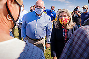 03 SEPTEMBER 2020 - RADCLIFFE, IOWA: SONNY PERDUE and Senator JONI ERNST talk to Iowa farmers Thursday. Perdue, the US Secretary of Agriculture, made a secretarial disaster declaration for 42 counties in central Iowa during a farm visit in central Iowa Thursday. Perdue was accompanied by Governor Kim Reynolds and US Senator Joni Ernst. The secretarial disaster declaration frees up more federal funds, from the Department of Agriculture, to help in recovery from the derecho storm that wiped out about one-third of Iowa's corn crop on Monday, August 10, 2020. Many Iowa farmers are still rebuilding lost buildings or plowing under lost crops.       PHOTO BY JACK KURTZ