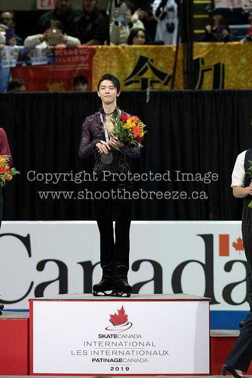 KELOWNA, BC - OCTOBER 27: Mens long program gold medalist, Japanese skater Yuzuru Hanyu stands on the podium at Prospera Place on October 27, 2019 in Kelowna, Canada. (Photo by Marissa Baecker/Shoot the Breeze)