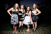 Felicia Pollos and Katie Mills hang out with their friends before the Coeur d'Alene High homecoming dance Saturday, Oct. 15, 2011.