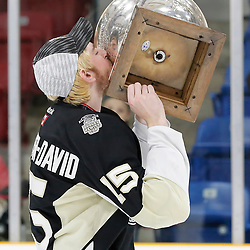 TRENTON, ON  - MAY 6,  2017: Canadian Junior Hockey League, Central Canadian Jr. &quot;A&quot; Championship. The Dudley Hewitt Cup Championship Game between The Trenton Golden Hawks and The Georgetown Raiders. Andrew Cordssen-David #15 of the Trenton Golden Hawks during post game celebrations. <br /> (Photo by Amy Deroche / OJHL Images)