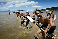 Waka practice on the beach outside Te Tii Marae on the eve of Waitangi Day. February 2004.<br />