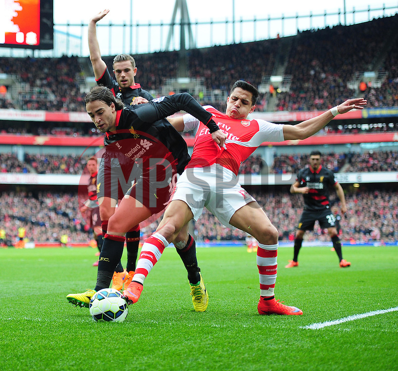 Alexis Sanchez of Arsenal Battles for the ball with Lazar Markovic of Liverpool  - Photo mandatory by-line: Alex James/JMP - Mobile: 07966 386802 - 04/04/2015 - SPORT - Football - London - Emirates Stadium - Arsenal v Liverpool - Barclays Premier League