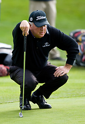 February 12, 2010; Pebble Beach, CA, USA; Mark O'Meara reads a put on the fourth hole during the second round of the AT&T Pebble Beach Pro-Am at Pebble Beach Golf Links.