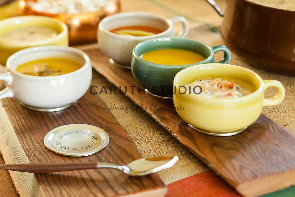 Sampler for soup buffet made with wood board and metal canning lids