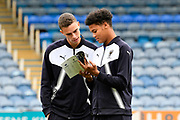 Nik Tzanev (25) of AFC Wimbledon and Toby Sibbick (20) of AFC Wimbledon reading the matchday programme before the EFL Sky Bet League 1 match between Portsmouth and AFC Wimbledon at Fratton Park, Portsmouth, England on 26 December 2017. Photo by Graham Hunt.