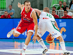 Edo Muric of Slovenia with huge move on Bojan Bogdanovic of Croatia at friendly match between Slovenia and Croatia for Adecco Cup 2011 as part of exhibition games before European Championship Lithuania on August 8, 2011, in SRC Stozice, Ljubljana, Slovenia. (Photo by Matic Klansek Velej / Sportida)