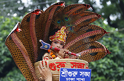 August 14, 2017 - Dhaka, Bangladesh - A couple poses as Sri Krishna and Radha on a peacock like float in a procession marking Janmashtami in Dhaka, Bangladesh on 14 August, 2017. The Hindu community of the country is observing Janmashtami, marking the birth of Lord Krishna, with due religious fervour.According to Hindu religion, Lord Vishnu incarnated in the universe as Lord Krishna in the prison of Raja Kangsa on this day, the eighth of 'Shukla Pakkha' (bright fortnight) in the month of Bengali calendar Bhadra in Dwapara Yuga in order to protect 'Dharma' from the hands of devils.Sri Krishna was born to Devaki and her husband Vasudeva in Mathura to which Krishna's parents belonged.Hindu community members will bring out processions in the capital, divisional cities and district towns displaying the eventful life of Krishna and hold other programmes on the occasion.Different social, cultural and religious organisations have chalked out elaborate programmes to observe Janmashtami.The day is a public holiday.President Abdul Hamid will host a reception at Bangabhaban marking the day.Meanwhile, the president and the prime minister, Sheikh Hasina, in separate messages greeted the members of Hindu community on the occasion of Janmashtami.Besides, national dailies have published special articles while Bangladesh Betar and Bangladesh Television and other private TV channels and radio stations are airing special programmes highlighting different aspects of the eventful life of Lord Krishna. (Credit Image: © Sony Ramany/NurPhoto via ZUMA Press)