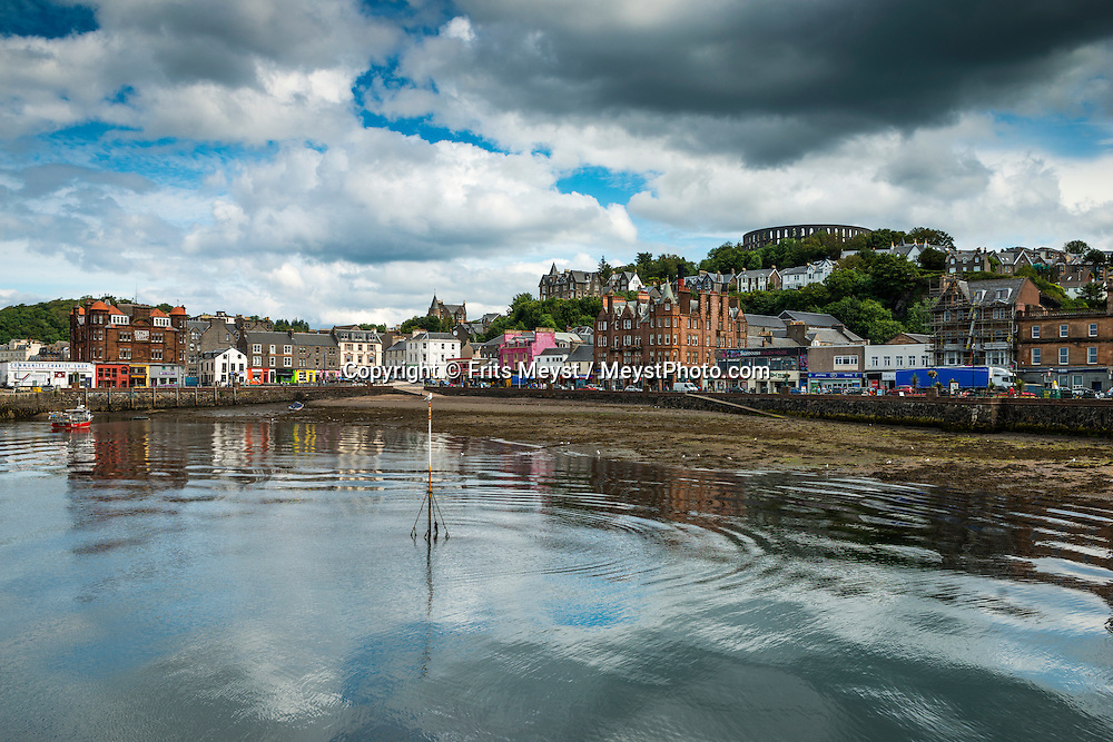 Oban, Scotland, United Kingdom, July 2015. Fishermen in the port of Oban, seafood capital of Scotland. The Scottish Highlands and wild coastline in combination with the dramatic weather patterns make the region a great outdoor adventure destination for the whole family. photo by Frits Meyst / MeystPhoto.com