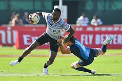 Sevuloni Mocenacagi of Fiji evades the tackle of Santiago Alvarez of Argentina <br /> <br /> Photographer Craig Thomas/Replay Images<br /> <br /> World Rugby HSBC World Sevens Series - Day 2 - Friday 6rd December 2019 - Sevens Stadium - Dubai<br /> <br /> World Copyright © Replay Images . All rights reserved. info@replayimages.co.uk - http://replayimages.co.uk