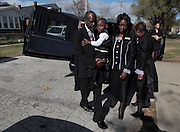 Clinton, left, along with he and Batey's son Trayvon Clinton, and Manuel Memorial Funeral Home Director Angela McDuffie-Manuel place Batey's urn in a hearse at the Cornerstone Missionary Baptist Church in Gary.
