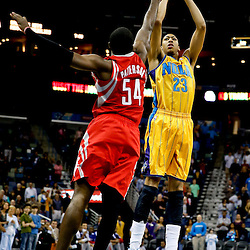 Jan 25, 2013; New Orleans, LA, USA; New Orleans Hornets power forward Anthony Davis (23) shoots over Houston Rockets power forward Patrick Patterson (54) during  the first quarter of a game at the New Orleans Arena. Mandatory Credit: Derick E. Hingle-USA TODAY Sports