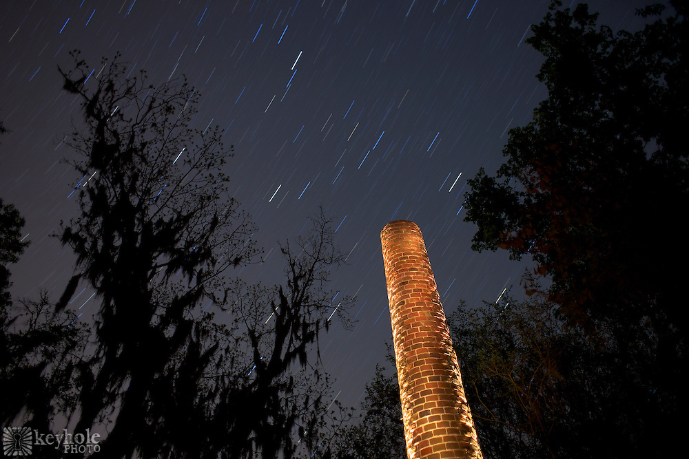 One of the remaining Crocheron Columns (circa 1843 stands out in the night sky at Old Cahawba Archaeological Park in Alabama during the early morning hours of Thursday, April 15, 2010. <br /> <br /> [The earth's rotation makes the stars appear to streak across the sky in this 9-minute exposure that includes flashlight illumination on the brick column.]