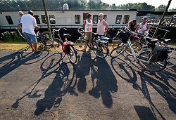 Tourists from Germany enjoy a Boat and Bike tour through Flanders. Tour members prepare their bicycles before departing for Damme, Belgium from Bruges, on Sunday July 11, 2010. (Photo © Jock Fistick)