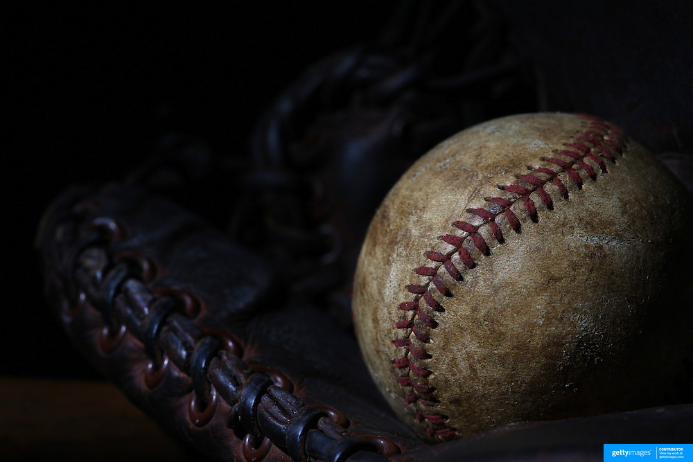 A vintage antique baseball glove and baseball mittt. 7th June 2012. Photo Tim Clayton