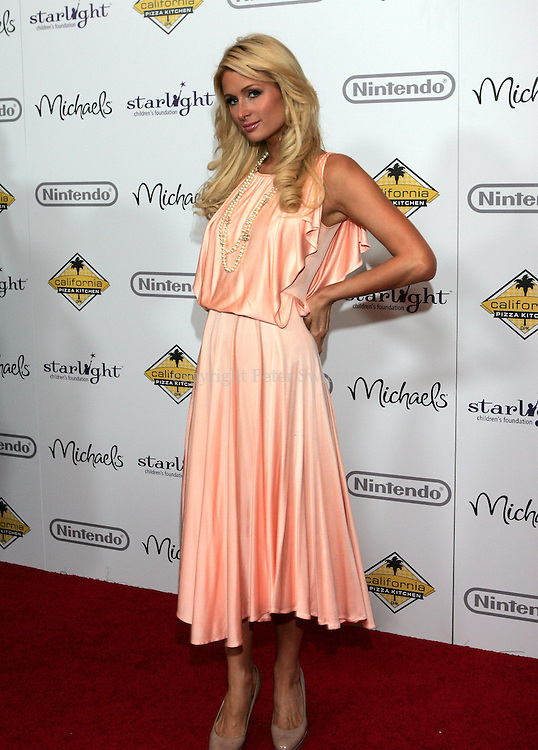 """Paris Hilton arrives on the red carpet at """"A Stellar Night"""" hosted by """"Starlight Children's Foundation"""" who are brightening the lives of seriously and terminally ill children in order to take their minds off the pain, fear and isolation of their illness. The Gala benefit was held at the Century Plaza Hyatt Hotel in Century City Ca. Saturday March 26, 2011. Photo by Peter Switzer"""