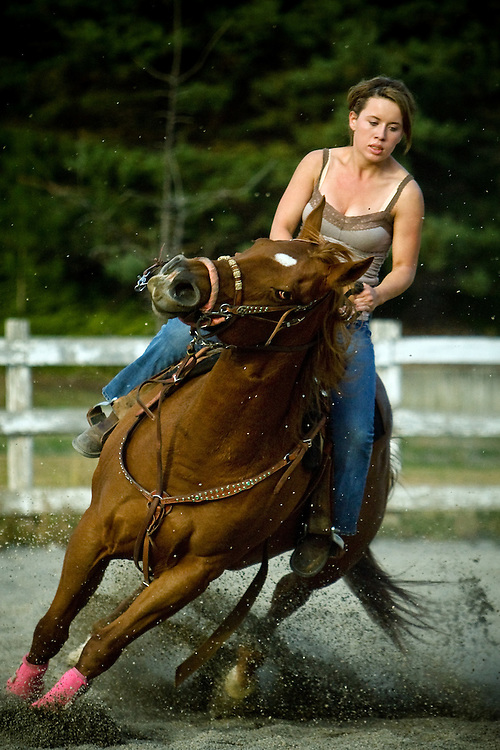 JEROME A. POLLOS/Press..Tyanne Jacklin makes a tight turn around a barrel Monday on her horse Cash at the Dalton Arena.