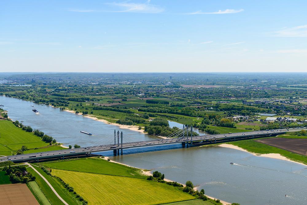Nederland, Gelderland, Ewijk, 13-05-2019;<br /> Waalbrug bij Ewijk, de Tacitusbrug in de A50 verbindt de knooppunten Ewijk en Valburg. De nieuwe tuibrug is gebouwd parallel aan de oude Brug bj Ewijk.<br /> Waal bridge at Ewijk, the Tacitus bridge in the A50 connects the Ewijk and Valburg junctions.<br /> <br /> luchtfoto (toeslag op standard tarieven);<br /> aerial photo (additional fee required);<br /> copyright foto/photo Siebe Swart