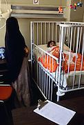Saudi mother with her child in Moda Hospital, Riyadh, Saudi Arabia.