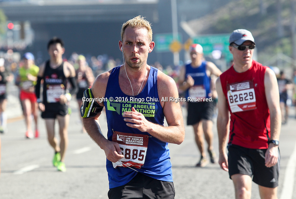 Runners make their way along Wilshire Boulevard during the 31st Los Angeles Marathon in Los Angeles, Sunday, Feb. 14, 2016. The 26.2-mile marathon started at Dodger Stadium and finished at Santa Monica.  (Photo by Ringo Chiu/PHOTOFORMULA.com)<br /> <br /> Usage Notes: This content is intended for editorial use only. For other uses, additional clearances may be required.