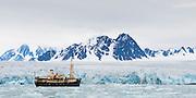 Expedition ship MS Origo anchored next to a glacier