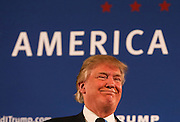 Republican presidential candidate Donald Trump smiles as he receives applause after speaking at a town hall meeting at Atkinson Country Club in Atkinson, N.H., Monday, Oct. 26, 2015.  (AP Photo/Cheryl Senter)