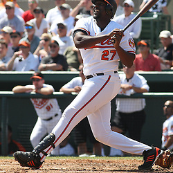 March 14, 2011; Sarasota, FL, USA; Baltimore Orioles designated hitter  Vladimir Guerrero (27) hits a sacrifice fly ball to left that allowed Randy Winn (not pictured) to score during a spring training exhibition game against the Pittsburgh Pirates at Ed Smith Stadium.   Mandatory Credit: Derick E. Hingle