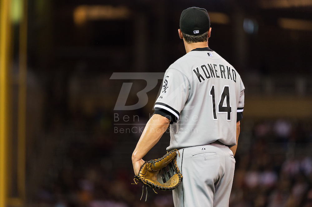 Paul Konerko #14 of the Chicago White Sox looks on during a pause in play against the Minnesota Twins on June 19, 2013 at Target Field in Minneapolis, Minnesota.  The Twins defeated the White Sox 7 to 4.  Photo: Ben Krause