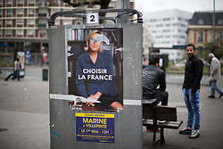 © Licensed to London News Pictures . 06/05/2017 . Paris , France . Flyers for Le Pen in the Saint-Ouen district of Northern Paris . The electorate are voting in the final round of the French election today (7th May 2017) . Emmanuel Macron's En Marche and Marine Le Pen's Front National are competing for the Presidency . Photo credit: Joel Goodman/LNP
