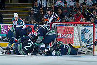 KELOWNA, CANADA - APRIL 30: Scott Eansor #8, Austin Strand #2, Nolan Volcan #26 and Carl Stankowski #1 of the Seattle Thunderbirds try to stop the puck from entering the net against the Kelowna Rockets on April 30, 2017 at Prospera Place in Kelowna, British Columbia, Canada.  (Photo by Marissa Baecker/Shoot the Breeze)  *** Local Caption ***