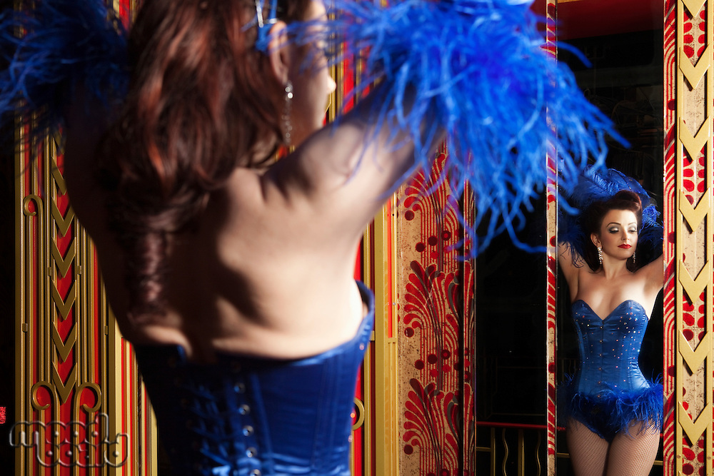 Showgirl posing in mirror